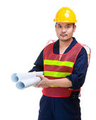 Engineer with layout drawing — Stock Photo