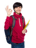 Student hold handbook with ok sign — Stock Photo