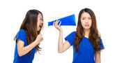 Woman yell to other with megaphone — 图库照片