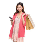 Woman with bags and phone — Stock Photo
