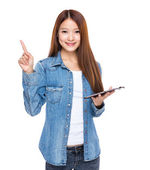 Woman hold tablet with finger point out — ストック写真