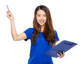 Woman hold clipboard and pen up — Stock Photo