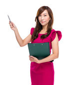 Mature businesswoman with clipboard pen up — 图库照片