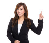 Businesswoman with finger indicate something — Stock Photo