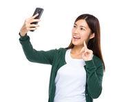 Woman take selfie by cellphone — Stok fotoğraf