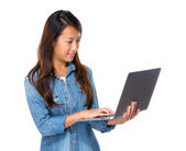 Singaporean woman use notebook — Stock Photo