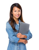 Singaporean woman with notebook computer — Stock Photo