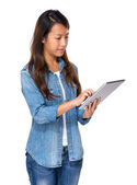 Singaporean woman use digital tablet — Stock Photo