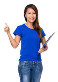 Woman with clipboard and thumb up — Stock Photo