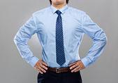 Businessman with hand on waist — Stock Photo