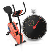 Exercise bike and stopwatch — Stock Photo