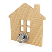 Wooden house with key — Stock Photo
