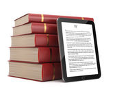 Tablet computer and stack of books — Stock Photo