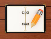 Notepad and pencil on wooden background — Foto Stock