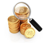 Coins and magnifier — Stock Photo