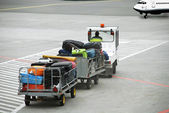 Luggage traffic on an electromobile to the plane — Stock Photo