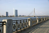 Riga. Quay of the river Dvina and a kind on the bridge. — Stock Photo