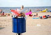 The overflowed garbage box on a beach. — Stock Photo
