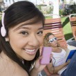 Asian Female Listening To Music On IPod — Foto de Stock