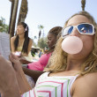 Caucasian Female Eating Chewing Gum — Stock Photo