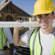Male Architect With Blueprint At Site — Stock Photo