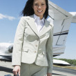 Happy BusinesswomWalking On Airfield — Stock Photo #21785051