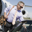 Senior Businessman Keeping Luggage In Car — Stockfoto