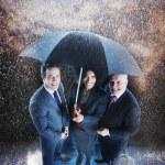 Businesspeople Under One Umbrella — Stock Photo