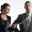 Female Executive Cleaning Glasses On Tie Of Businessman — Stockfoto