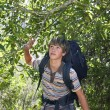 Teenage Boy Walking In Forest — Stockfoto