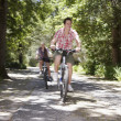 Stock Photo: Teenage Boys Bicycling In Forest