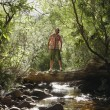 Teenage Boy Standing On Log Over Stream — Stock Photo