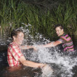 Friends Splashing Water At Each Other — Stock Photo