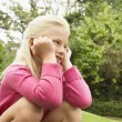 Stock Photo: Girl Crouching In Park