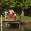 Family About To Jump In Water — Stock Photo