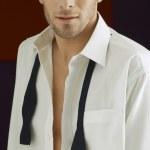Smart Man Wearing Unbuttoned Shirt — Stock Photo #21788031
