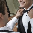 Man Adjusting Senior Man's Bow Tie — Stock Photo #21788461