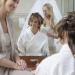 Woman Dressing Bride's Hair — Stock Photo