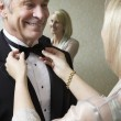 Woman Tying Man's Bow Tie — Stock Photo