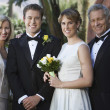 Newly Married Couple Standing With Parents — Stock Photo