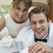 Stock Photo: Newlywed Couple In Bed