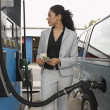 Woman Refuelling Car At Petrol Pump — Stock Photo