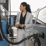 Woman Refuelling Car At Petrol Pump — Stock Photo