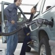 Couple Pumping Gas Into Car — Stock Photo #21788991