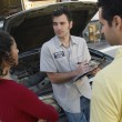 Couple Talking To Car Mechanic — Stock Photo