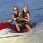 Young Couple Riding PWC On Lake — Stock Photo #21789595