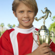 Young Boy Holding Soccer Trophy — Stock Photo