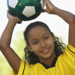 Girl Holding Soccer Ball — Stock Photo #21789795