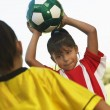 Girl About To Throw The Soccer Ball - Stock Photo