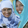 Muslim Women With Mobile Phone - Stock Photo